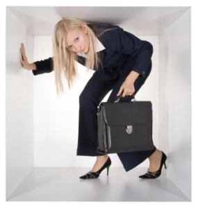 blonde businesswoman with black suitcase in the white cube